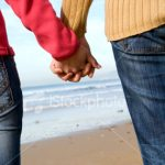 stock-photo-4890702-couple-holding-hands